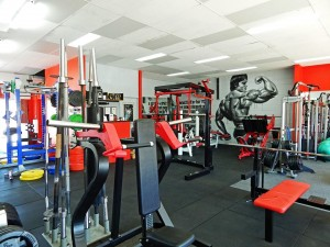 Barbells, shoulder press machine and more at Coco's Gym Gold Coast