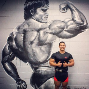 Coco with his mural of Arnold Schwarzenegger