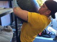 Sean lifting his first 109kg Atlas Stone