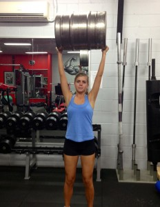 Arielle practicing the keg press for strongman
