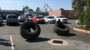 Check out the girls doing a tyre flip race as a part of Strongman Training