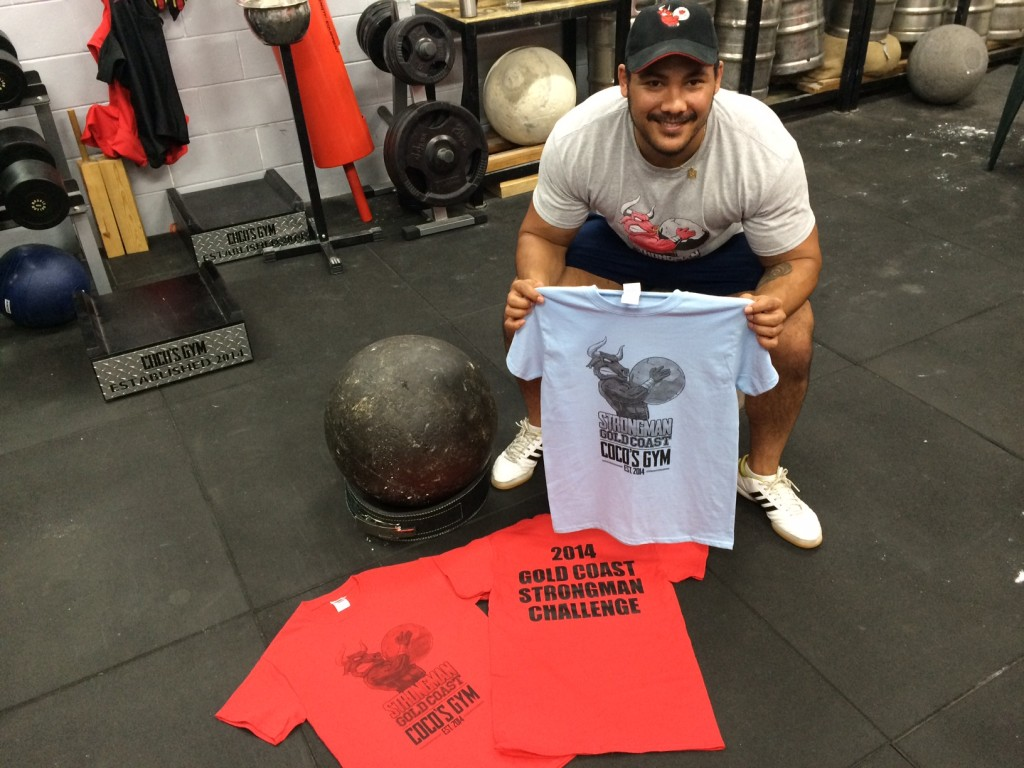 Coco with the newly arrived shirts ready for the Gold Coast Strongman Challenge