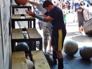 Alex preparing to start the Atlas Stone series, 109kg, 112kg, 120kg, 132kg
